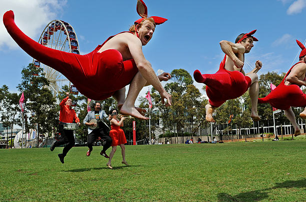 Performers from the Australian Circus Oz masquerade as kangaroos during a media call at Tumbalong Park in Sydney.