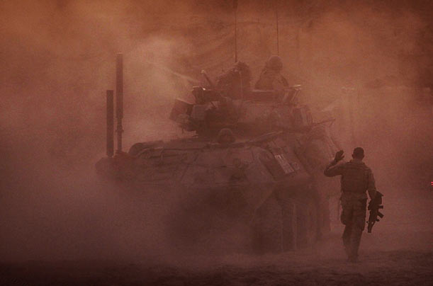 A Marine walks toward a LAV fighting vehicle in Khan Nashin, in the volatile Helmand Province of Afghanistan.