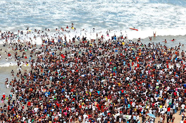 Close to 100,000 people spend Reconciliation Day at the beach in Durban, South Africa. Reconciliation Day was established as a paid