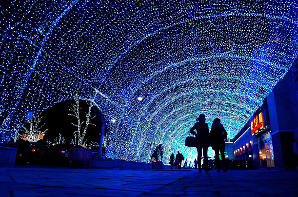 A shopping center is lit up in Beijing.