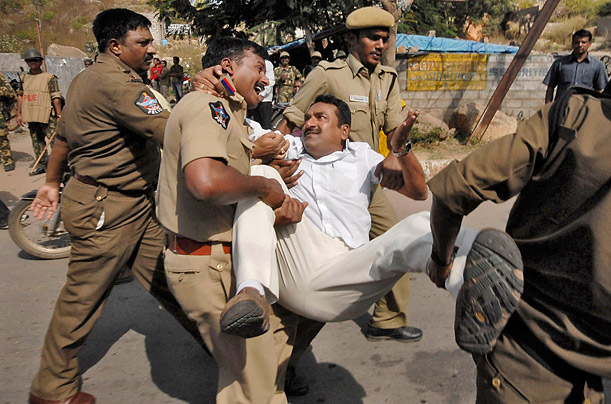 Policemen in Hyderabad, India detain a man during a demonstration in favor of the creation of the new state of Telangana.
