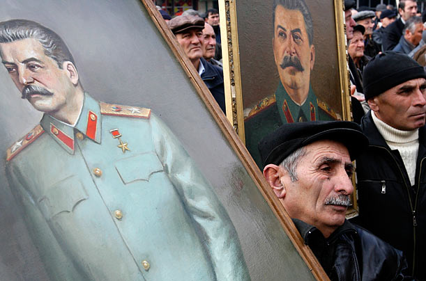 Georgians carry portraits of Soviet dictator Josef Stalin during a rally marking his 130th birthday anniversary in Stalin's home town of Gori.