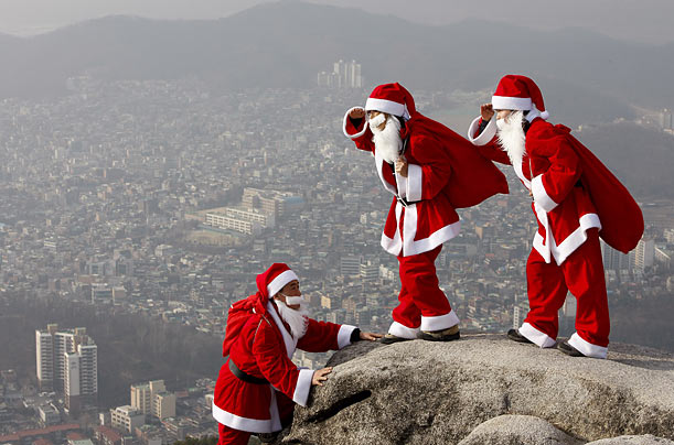 South Korean climbers wear Santa Claus costumes while rock-climbing during an event on Buckhan mountain near Seoul.