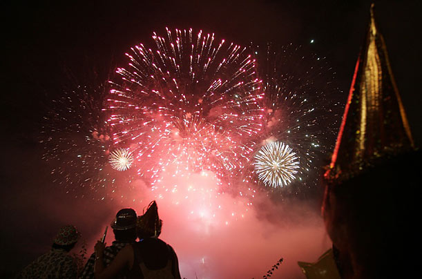 Malaysian people watch fireworks during New Year celebrations in Petaling Jaya, near Kuala Lumpur.