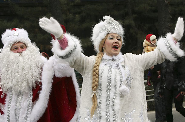Father Frost and a Snow Maiden sing during a New Years parade in Bishkek, Kyrgyzstan.