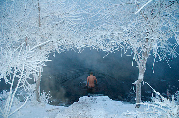 A swimmer wades into the Songhua River in Jilin, China.