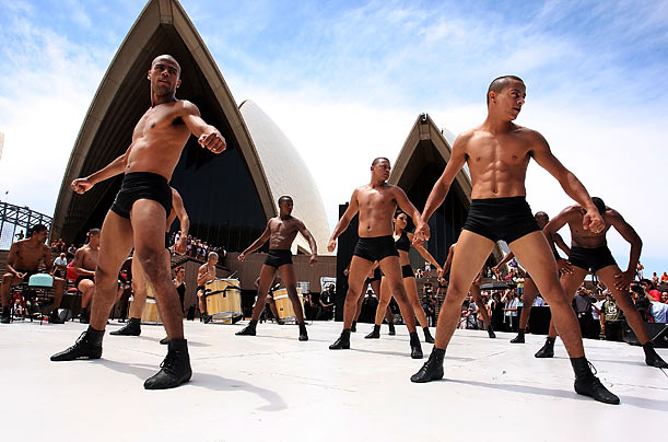 Cast members from the Brazilian dance troupe Bale de Rua perform a routine in front of the iconic opera house in Sydney, Australia.