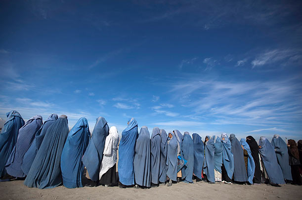 Afghan widows line up to participate in a cash-for-work project sponsored by CARE International in Kabul, Afghanistan.