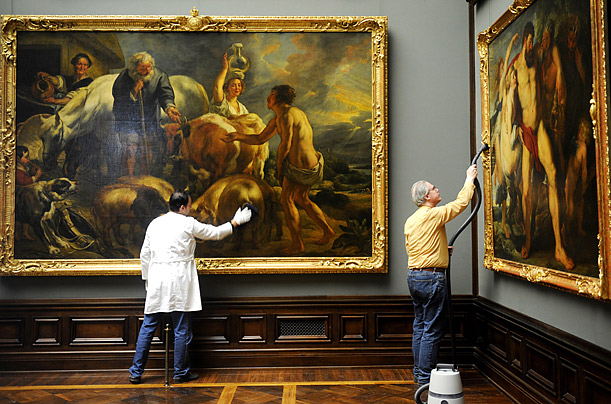 At the Zwinger gallery in Dresden, Germany, art restorers give the paintings their yearly cleaning.