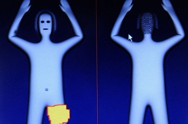 Members of the press are given a demonstration of Amsterdam's Schiphol airport's security body scanner.