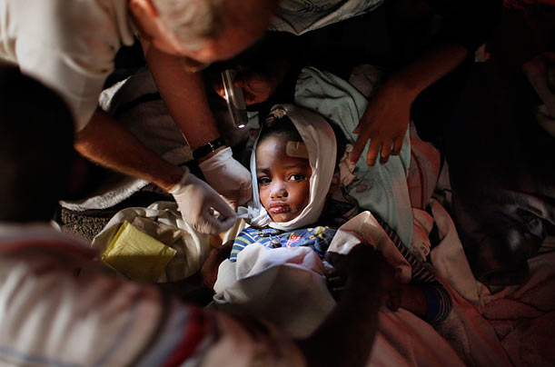 A injured child receives medical treatment after a 7.0 magnitude earthquake devastated Port-au-Prince, Haiti.