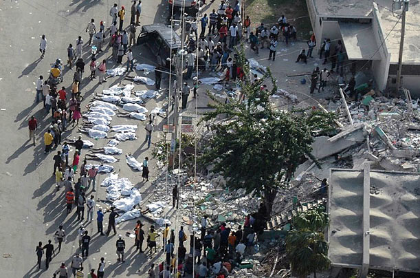 Survivors in Port-au-Prince, Haiti gather around the bodies of those who perished in the earthquake.