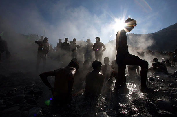 Hindu devotees bathe in a natural hot water spring during the Hindu festival of Makar Sankranti, at Tattapani, India.