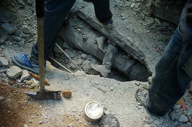 Excavation efforts continue as workers search for survivors amidst the destruction caused by the earthquake that hit Port-au-Prince, Haiti.