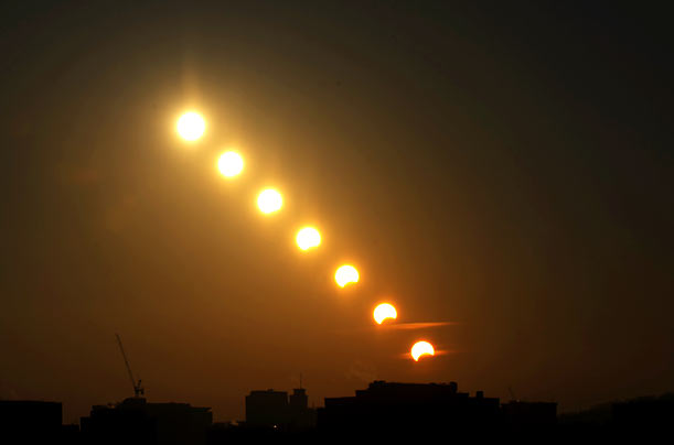 This multiple exposure photograph shows a partial solar eclipse over Seoul, Korea.