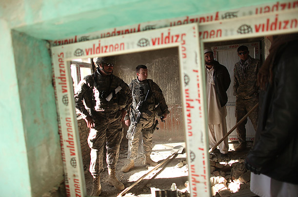 Members of a Provincial Reconstruction Team and the 3509 Maneuvers unit inspect a hospital they are overseeing and financing in Orgune, Afghanistan.