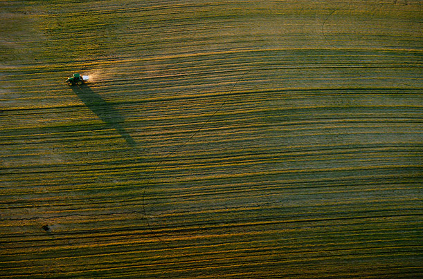 A tractor traverses a field near the Donana Natural Reserve in southwest Spain.