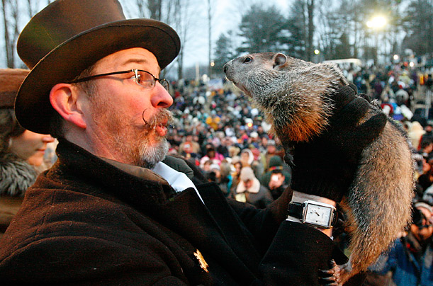 Groundhog / weather guru, Punxsutawney Phil, emerged from his burrow on Gobblers Knob in Punxsutawney, PA, to see his shadow and forecast six more weeks of winter weather.