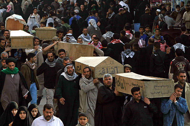 Victims of a suicide bombing are taken for burial in the Shiite city of Najaf, Iraq.