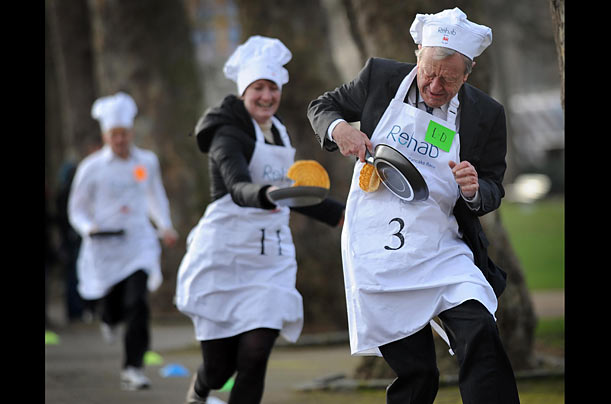 British Labor Party politician Lord Alfred Dubs (right) and Allegra Stratton,  of The Guardian newspaper, compete in the annual