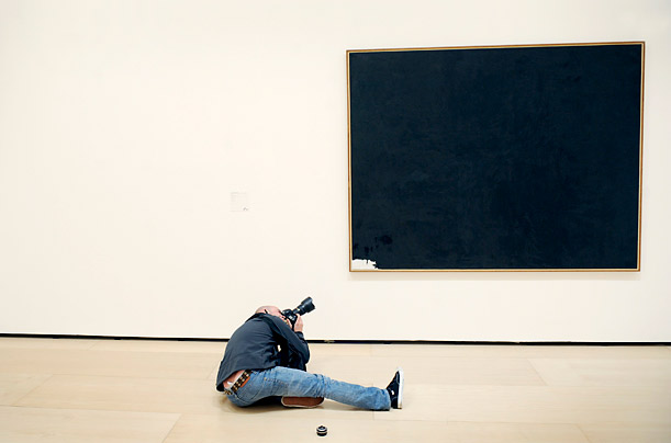 A photographer takes pictures of U.S. abstract expressionist artist Robert Motherwell's 1958 work