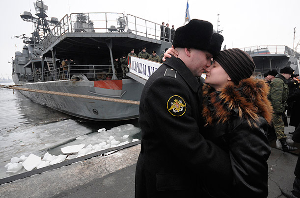 A crew member stands with his wife during farewell as the Marshal Shaposhnikov anti-submarine destroyer prepares to leave the  to curb piracy at the Horn of Africa.