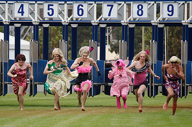 Drag Queens race on the main straight of the Randwick Horse racing course during the Pink Stiletto race day in Sydney, Australia.