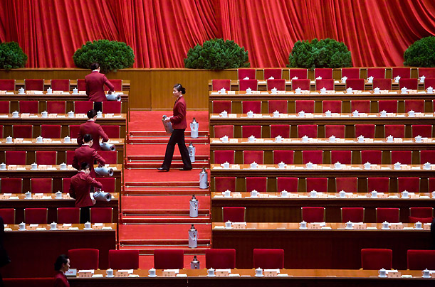 epa02063211 Stewardesses fill teacups for delegates before the opening ceremony of the 3rd session of the 11th National Committee of the Chinese People's Political