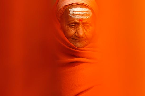 A Hindu woman performs rituals after bathed in the River Ganges as part of the Kumbh Mela Festival in India.