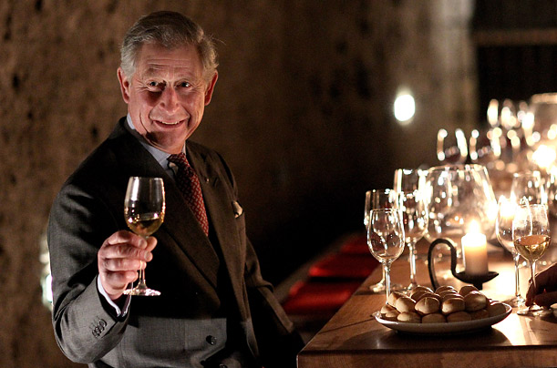 In Budapest, Prince Charles enjoys a wine tasting.