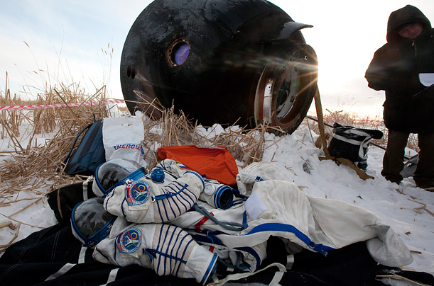 The space suits of NASA astronaut Jeff Williams and Russian cosmonaut Maxim Surayev lie on the ground after landing safely in northern Kazakhstan.
