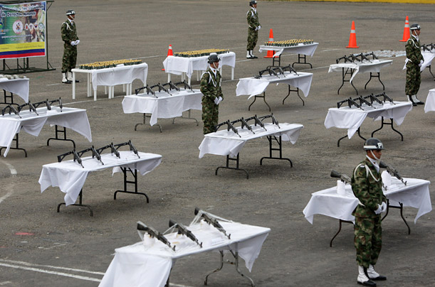 Colombian soldiers stand guard as confiscated rifles, grenades and ammunition are displayed for the media in Villavicencio March 22, 2010. The rifles, grenades and ammunition were seized in San Martin province during an army