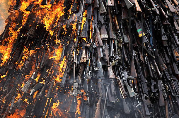 An assortment of illicit firearms recovered by the police are destroyed at the Uhuru Gardens in Nairobi, Kenya.
