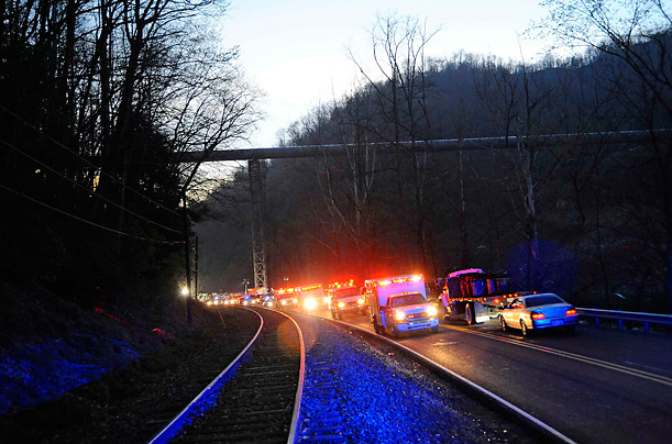 In Montcoal, West Virginia, emergency vehicles leave Massey Energy's Upper Big Branch Coal Mine on Monday evening after an explosion at the mine trapped many workers and left at least 25 dead.