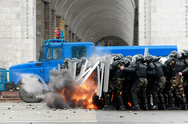 In Kyrgyzstan's capital, Bishkek, riot police come under attack by anti-government protesters.