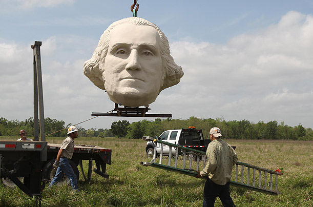 At Pearland, Texas's Presidential Park a giant bust of George Washington is dismantled because the park has been placed under foreclosure.