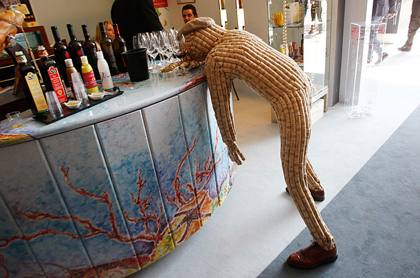 A dummy made of corks, representing a drunk man, leans on a bar counter at  the 44th edition of the annual International Wine and Spirits Exhibition 