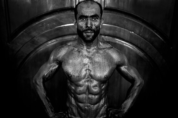 An Afghan bodybuilder poses for a photo during a regional bodybuilding competition in Kabul.  Bodybuilding is a very popular sport in Afghanistan.