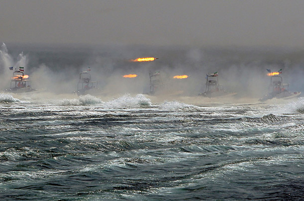 Iranian boats take part in naval war game in the Persian Gulf and the Strait of Hormuz