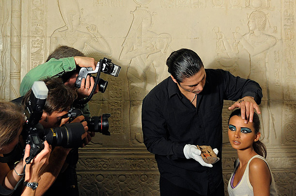 A makeup artist applies historical Egyptian beauty items and toiletries at The Science Museum in London.
