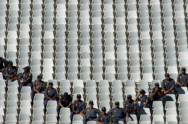 Members of the South African police force sit in the Cape Town Stadium to watch the launch of the FIFA World Cup State of Readiness campaign in Cape Town, South Africa.