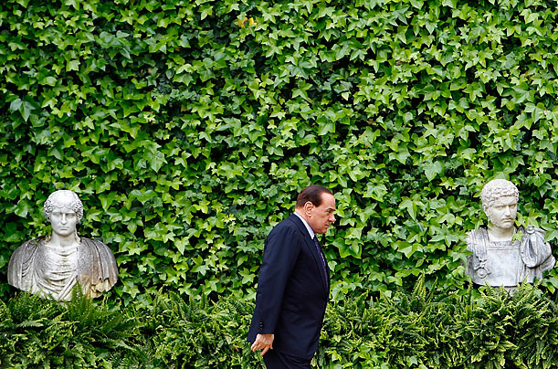 Italian Prime Minister Silvio Berlusconi walks to meet the Emir of Kuwait, Sheikh Sabah Al-Ahmad Al-Jaber, at Villa Madama in Rome.