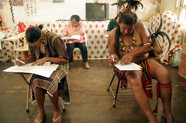 Indigenous people wearing traditional costumes cast their votes at a polling center in Baguio City, north of Manila in the Philippines.