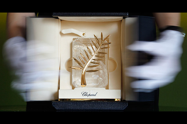 A Chopard representative displays the Palme d'Or, the highest prize awarded to competing films at The Cannes Film Festival, which will run May 12th to May 23rd.