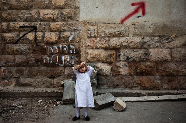 An Ultra Orthodox Jewish girl stands on a street in the religious neighborhood of Mea Shearim in Jerusalem.