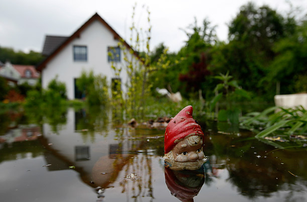 A garden gnome sits just above flood waters from the Oder river near the Polish border.