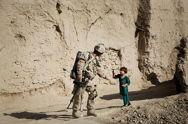An Afghan girl greets a Canadian soldier patroling Salavat, in the Panjwayi district, southwest of Kandahar.
