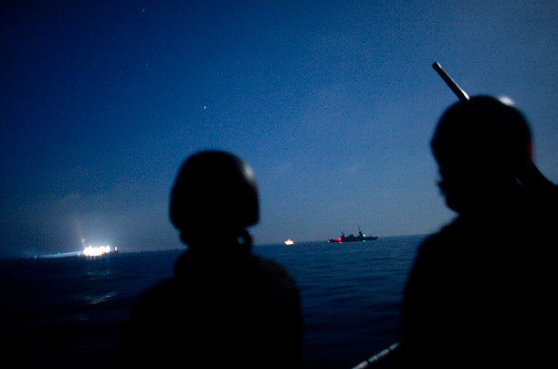 Israeli Navy soldiers stand guard on a missile ship as the Israeli Navy intercepts peace boats bound for the Gaza Strip.