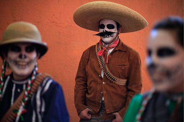 Women dressed as Escaramuzas, also known as cowgirls, and a Charro are seen before their performance during the anniversary of the inauguration of Lienzo La Nacional, in Mexico City.