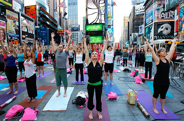 People gather in New York's Times Square to practice yoga in the eighth annual